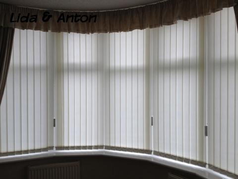 Вертикальные жалюзи и шторы