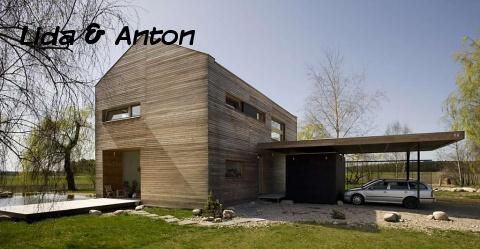 Деревенский дом с гаражом навесом